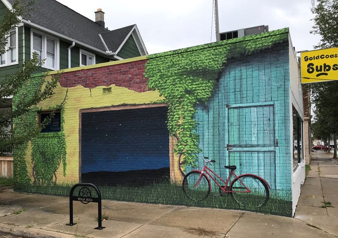 """A mural called """"Second star to the right"""" now graces the east-facing wall of the Goldcoast Subs building at 5901 W. Burnham St., West Allis. The painting was created by Algoma artist Erin LaBonte in collaboration with Don Krumpos and David Carpenter."""