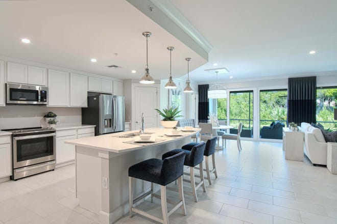 Shaker style wood cabinetry is used throughout with soft-close features, as are 42-inch high Kitchen upper cabinets and wide profile, porcelain tile flooring in all living areas with designer-level carpeting in the Bedrooms.