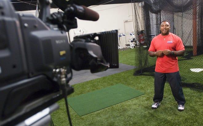 gr-tvbaseball0603-135412-Host of Baseball Player University Jeff Forney (cq) right films a segment of his show in studio in Mesa, Arizona Tuesday. Photo by Jeremiah Armenta The Arizona Republic