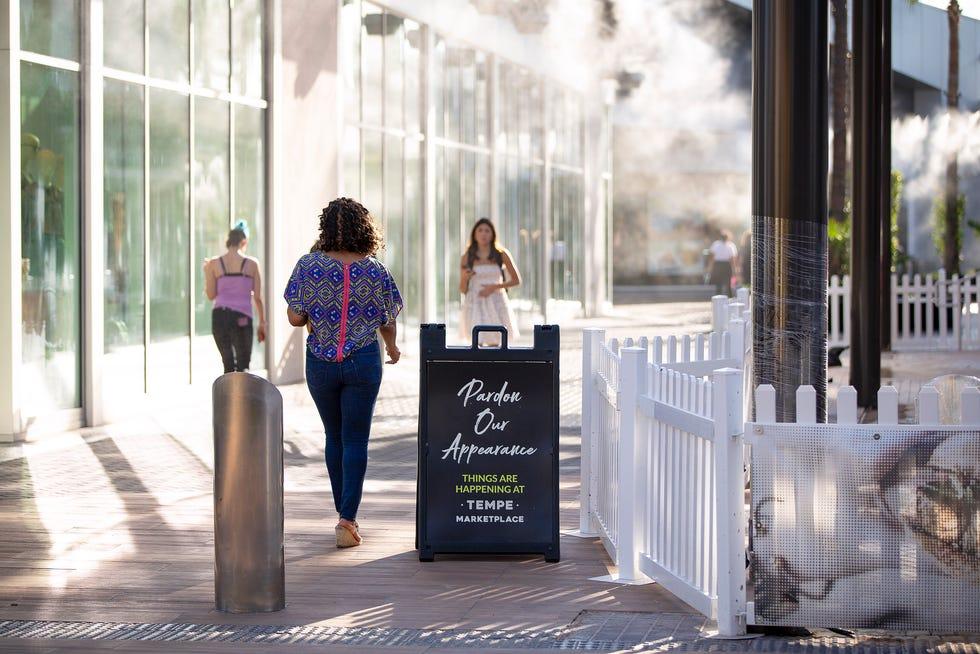 Consumers walk through Tempe Marketplace, a Vestar mall, on Sept. 20, 2021.