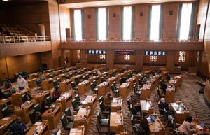 Oregon State Representatives congregate in the House, prior to the meeting being adjourned due to a covid-19 exposure, during a special legislative session for redistricting congressional maps at the Oregon State Capitol in Salem, Ore. on Tuesday, Sept. 21, 2021.
