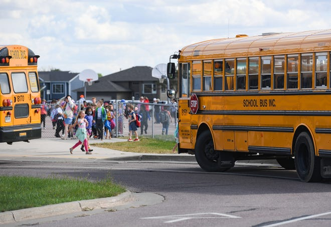 School buses line up to bring students home from school on Tuesday, September 21, 2021, at RF Pettigrew Elementary School.