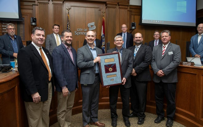 Springfield Department of Public Works and Environmental Services accept an APWA accreditation Monday, September 20, 2021.