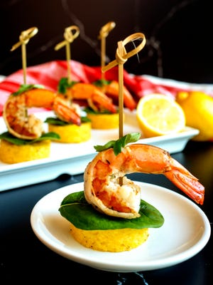 Succulent shrimp are mounted on top of Smoked Gouda Grits rounds for a perfect appetizer.