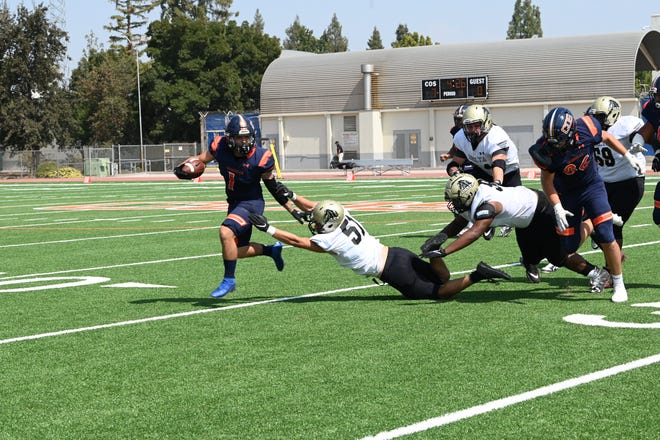 College of the Sequoias running back Jaedyn Pineda battles for yards against Delta on Sept. 18 in a non-conference game in Visalia.