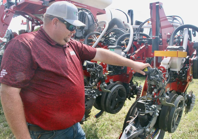 Cody Miller, Swiderski Precision Farming specialist, points out the location of the Smart-Depth technology on the corn planter.