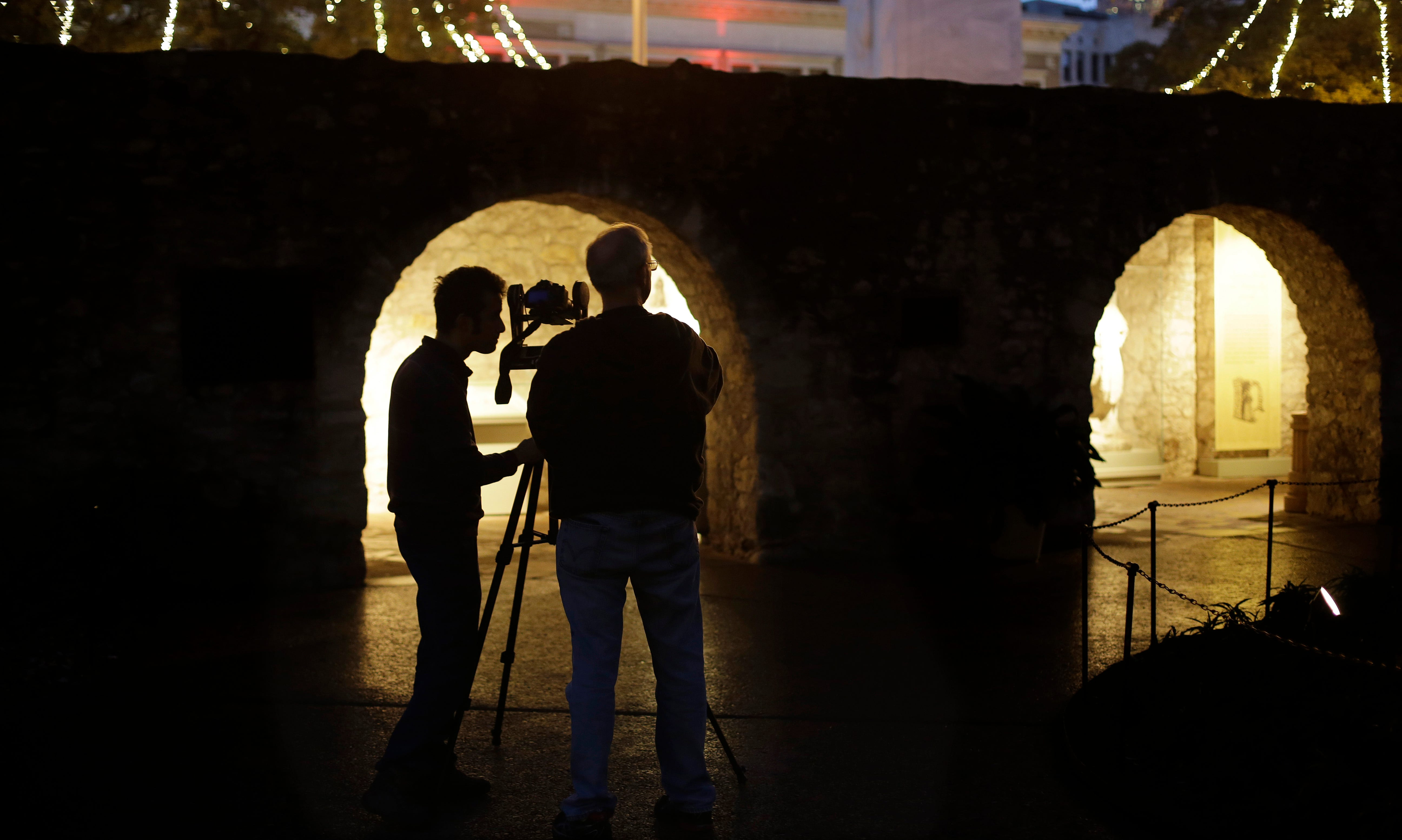 In this Jan. 9, 2014 photo, Soheil Hamideh, left, and Bob Warden, right, professor of architecture and director of the Center for Heritage Conservation at Texas A&M, use a camera to record images of the Alamo's long barrack, which was originally constructed in 1724.
