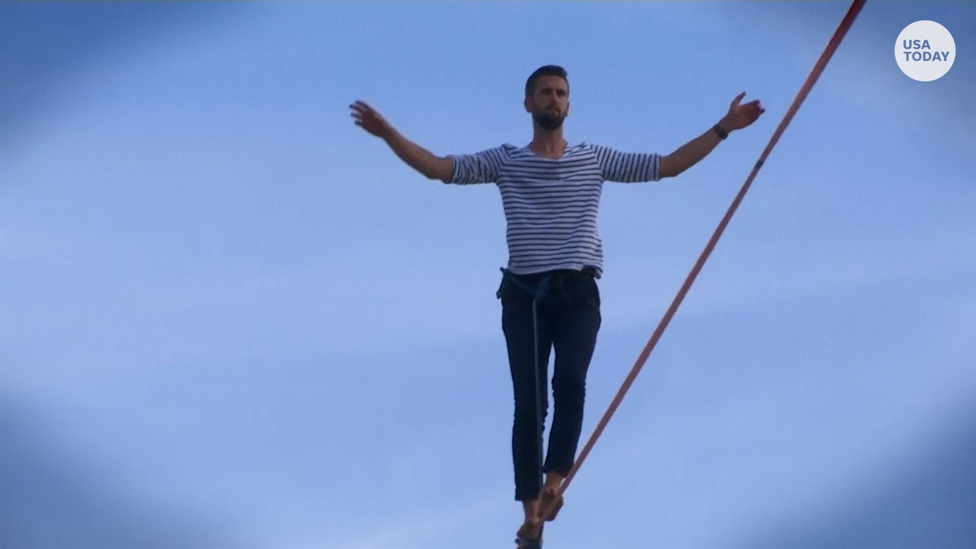 Don t look down: Tightrope walker completes 2,198-foot walk from Eiffel Tower