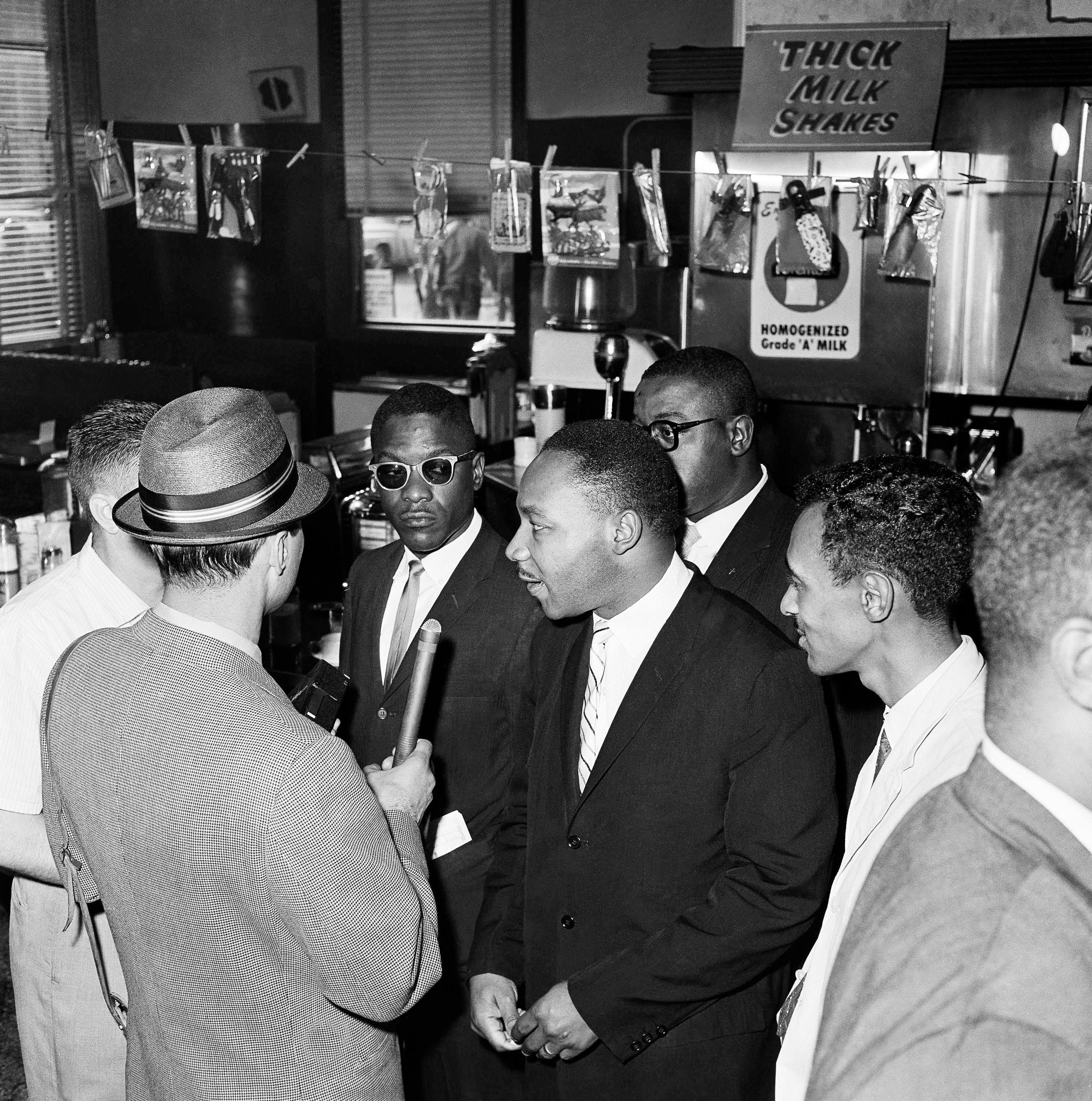 Freedom Riders at the bus station in Montgomery, Ala., on May 24, 1961, wait to purchase tickets to continue their ride through the South. At center is civil rights leader Martin Luther King Jr.