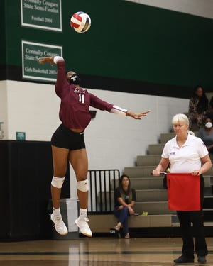 Emma Patmon launches a jump serve for Bastrop in set one against Connally in District 18-5A play Tuesday at Connally High School. Bastrop won the match 3-0 behind 17 kills and nine aces from Patmon.