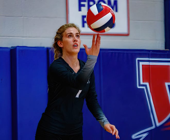 Vandegrift's Chloe Charles, serving the ball against Westlake in the season opener, had 14 kills as the Vipers swept Cedar Ridge to stay in second place in the District 25-6A race.