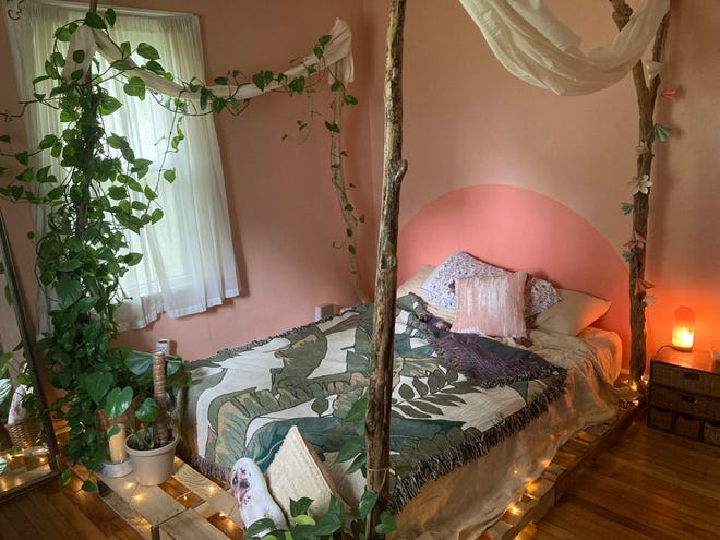 Lake Erie driftwood is used to create a charming, nature-inspired bedroom oasis.