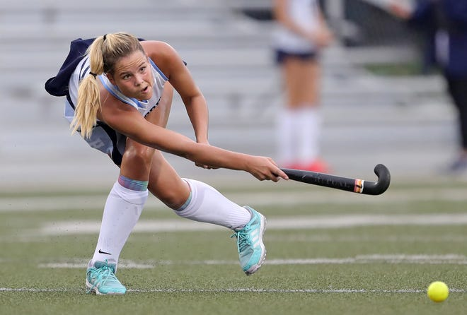 Hudson's Hannah Widdoes makes a pass during the first half of a field hockey match against Kent Roosevelt, Tuesday, Sept. 21, 2021, in Hudson, Ohio. Hudson won the match 10-0.