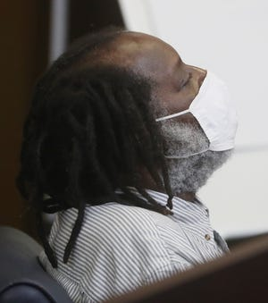 Stanley Ford leans back his head as he listens to the guilty verdicts in his murder trial in Summit County Common Pleas Judge Christine Croce's courtroom on Tuesday, Sept. 21, 2021, in Akron.