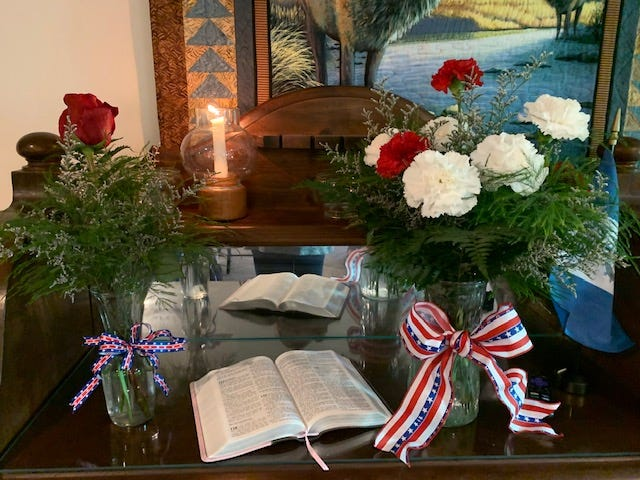 Jane Bain Chapter of Daughters of the American Revolution set up a Memorial Table to honor those lost in the terrorist attacks of Sept. 11, 2001, and club members who died over the past decade.