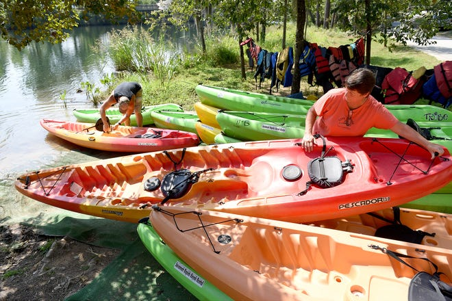 Leslie Wright, right, co-owner of Savannah Rapids Kayak Rental, and Shane Leskanich get kayaks ready for a group of paddlers near Savannah Rapids Pavilion in Martinez, in this photo from 2015.