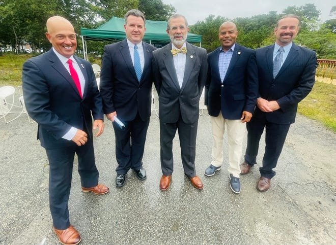 Celebrating the start of construction on Barnstable's Comprehensive Wastewater Management Plan are, from left: State Rep. Steven Xiarhos; Town Councilor Eric Steinhilber; DPW Director Dan Santos; Rep. Kip Diggs; and Town Council President Matthew Levesque.