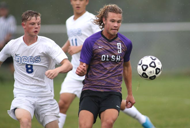 Olsh's Andrew Griesacker (9) and Beaver County Christian School's Dan Thoman (8) prepare to compete for the ball during the second half Tuesday evening at Youthtowne Field in Imperial.
