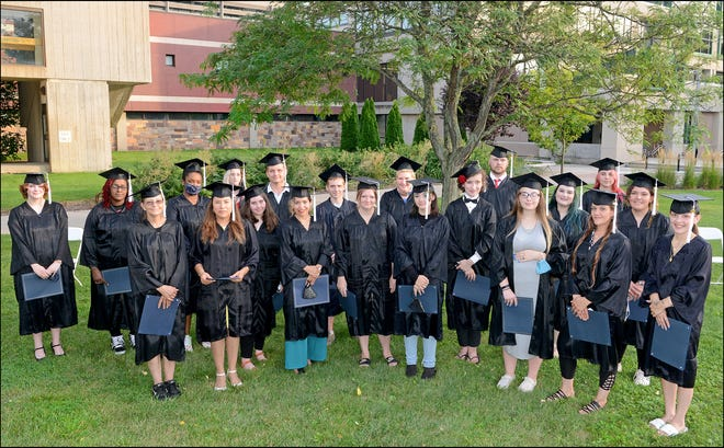 Some of the graduates in Finger Lakes Community College's largest high school equivalency class chose to participate in a ceremony at the main campus Aug. 25.