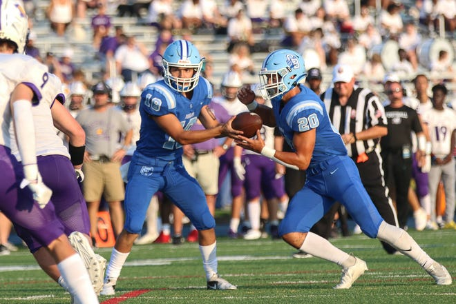 Olentangy Berlin's Dylan Reyes hands off the ball to Nick Tiberio on Aug. 20 against DeSales. Reyes has completed 48 of 84 passes for 708 yards and five touchdowns this season.