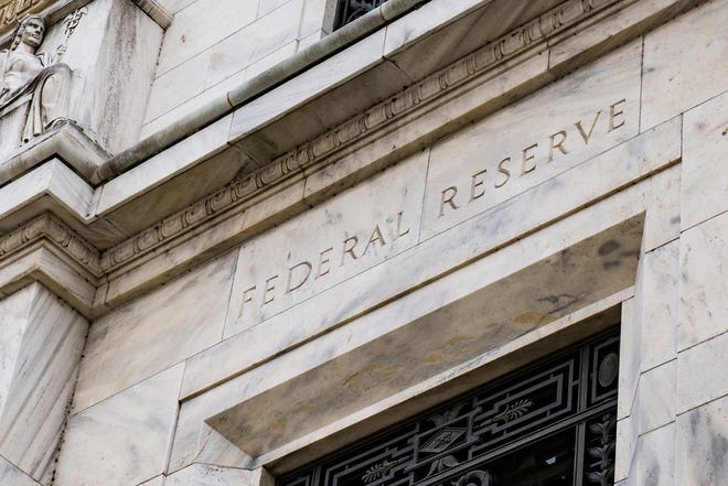 Federal Reserve officials revealed a growing inclination to start raising interest rates in 2022.