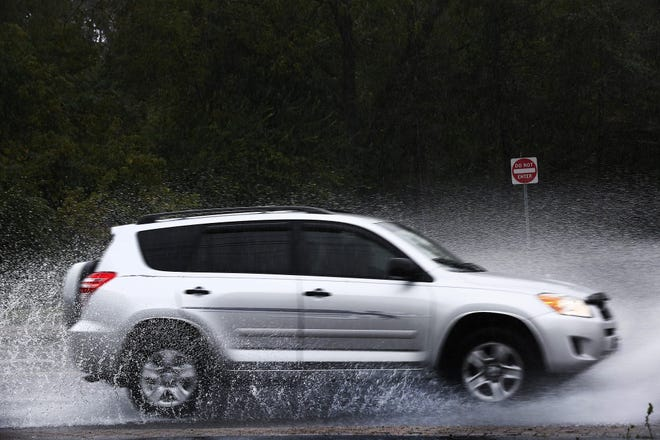 A car passes through a puddle on Granville St. in Gahanna on Wednesday, September 22, 2021.