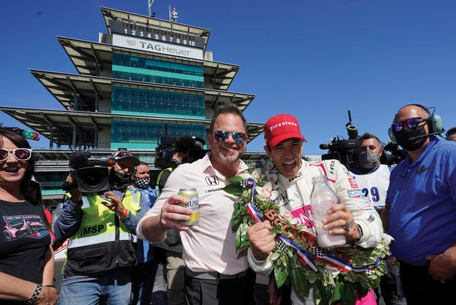 Shank and Hélio Castroneves celebrate after the Indianapolis 500.