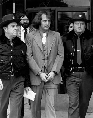 Billy Milligan leaves the Franklin County Hall of Justice after being found innocent by reason of insanity of a series of Ohio State University-area crimes in 1968.
