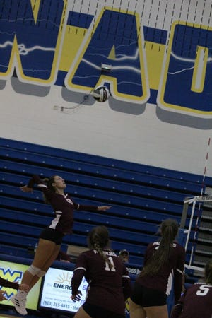 John Glenn's Emma Johnson (20) goes up for a kill during Tuesday's Muskingum Valley League match at West Muskingum.