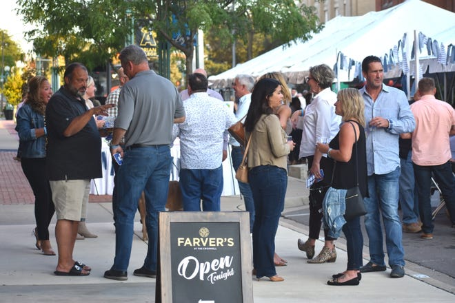 The 15th annual Blue Jean Ball fundraiser, hosted by the Boys and Girls Club of Lenawee, took place Sept. 10 in downtown Adrian for the first time. Nearly 200 people attended after the event was conducted virtually last year because of the COVID-19 pandemic. Organizers are calling this year's in-person fundraiser a success.