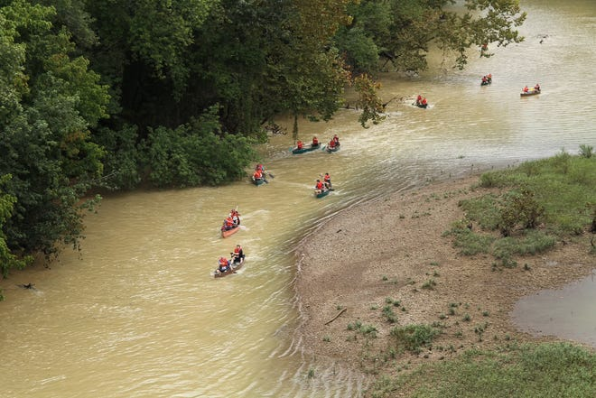 Competitors race in canoes during the first leg of the Columbia Cycling Club's Jailbreak Triathlon at Chickasaw Trace Park in Columbia, Tenn., on Saturday, Sept. 18, 2021.