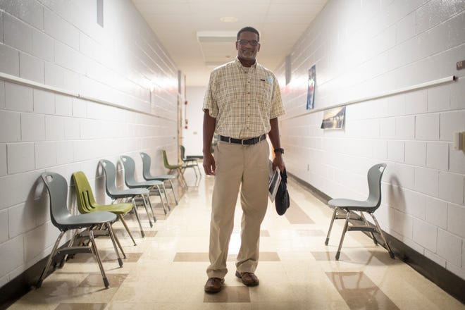 Maury County School Board District 3 representative Winston Harlan stands in a hallway at Horace O. Porter School in Columbia, Tenn., on Tuesday, Sept. 2021, where he once walked as a student.