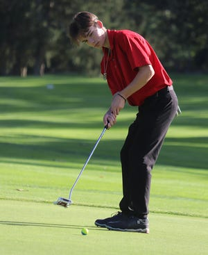 Brockton High's Jimmy Dragonetti putts in a match against Durfee at DW Field Golf Course in Brockton on Tuesday, Sept. 21, 2021.