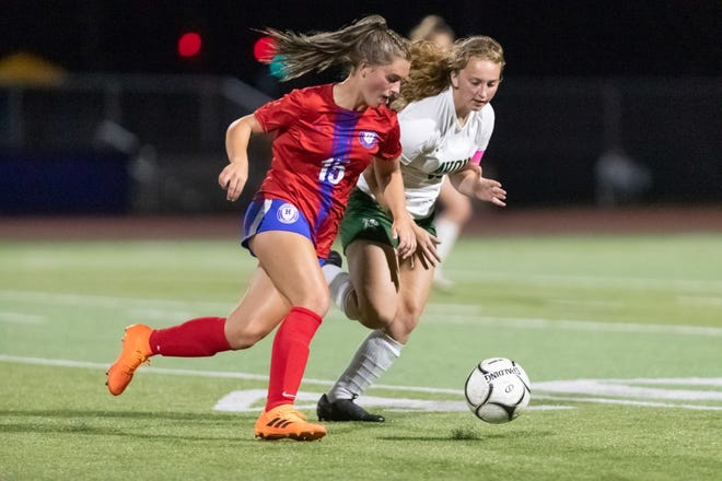 Hornell's Ireland Harrison pushes the ball down the field on Tuesday evening in a win over Avon during Homecoming week.