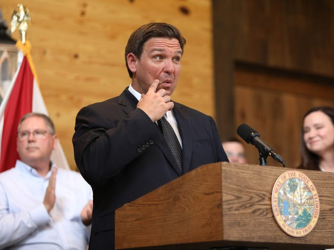 Florida Gov. Ron DeSantis delivers comments during an anti-vaccine mandate rally at Clark Plantation in Newberry on Sept. 13.