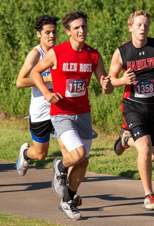 Glen Rose freshman Andrew Clark, seen here in action last week at the Glen Rose Invitational at Squaw Valley Golf Course, medaled Wednesday in Keene by finishing 14th with the time of 19:51.31.