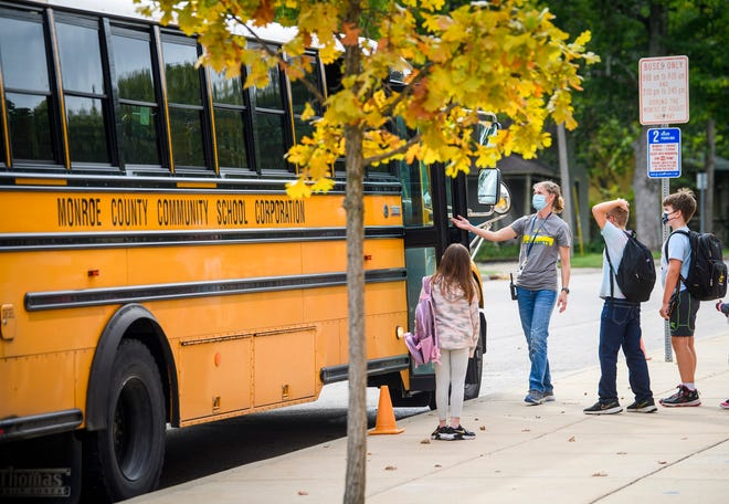 Fairview Elementary Assistant Principal Jamie Burkhar helps students get on a bus on Tuesday, Sept. 21, 2021.