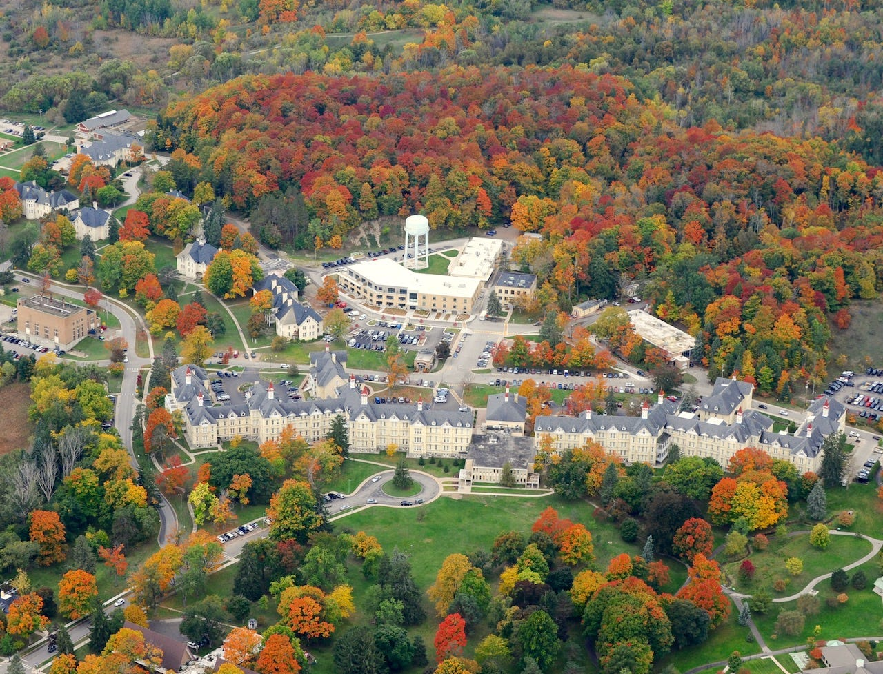 An aerial view of The Village at Grand Traverse Commons in autumn. The community was once Traverse City State Hospital, opened as an asylum in 1885.