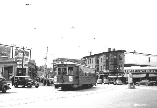 Car 5712 rounds the bend at Brigham Circle bound for Dudley Square. To the right of the car can be seen Kline Drug, Circle Restaurant and the First National grocery store. To learn a lot more, visit the Jamaica Plain Historical at www.jphs.org.