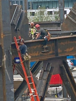 These people are hard at work over the Fort Point Channel.