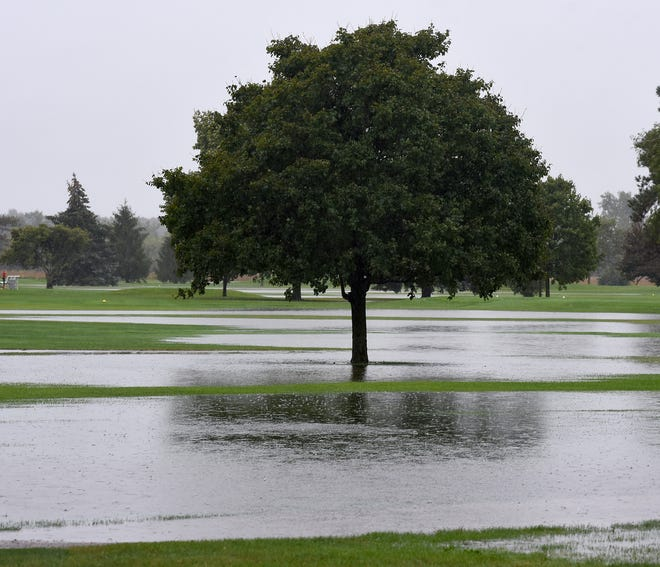 Green Meadows Golf Course in Monroe had a few too many water hazards Wednesday, as heavy rainfall had started to flood the fairways.