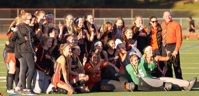 The Hackettstown field hockey team celebrates its victory during the H//WS Final against Warren Hills, Saturday, Oct. 20, 2018, at Newton High School, in Newton.