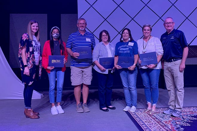 Presenting scholarships were, far left, Taler Alexander, Southwestern Oklahoma State University assistant director of enrollment  management, and, far right, Todd Boyd, SWOSU director of enrollment management. High school counselors receiving scholarships for a senior at each of their schools were, second from left, Prisma Espinoza,Brian Collums, Brenda Stinnett,Debra Boothand Erin Bickle.