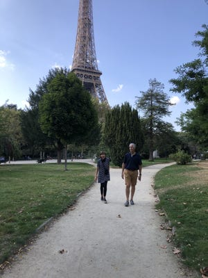 Alison Oshel's husband and sister walk in a nearly vacant Champs de Mars in Paris.