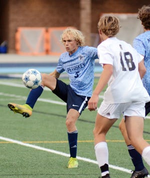 Petoskey's Sam Smith settles the ball down near the sideline during the first half of play against TC Central Tuesday.