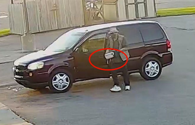An image from surveillance video showing a man which appears to be John Allen transporting a box containing an explosive device outside the AT&T store in Sault Ste. Marie on Sept. 15.