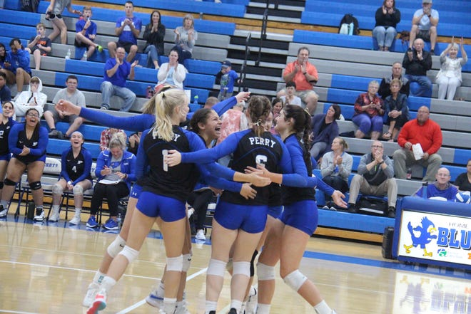Jayette players come together to celebrate a point during a match against Roland-Story on Tuesday, Sept. 21 in Perry.