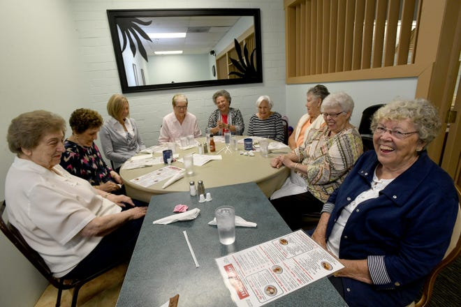 A group of women who have been friends for more than 70 years as classmates from the old St. Mary's School in Canton meets regularly for lunch at Gregory's Family Restaurant. They are seen here on Sept. 20.