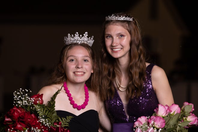 Martinsville Homecoming Queen Emma Gonzales, left, and Princess Briana Hudson pose for a photo after being crowned Saturday night.