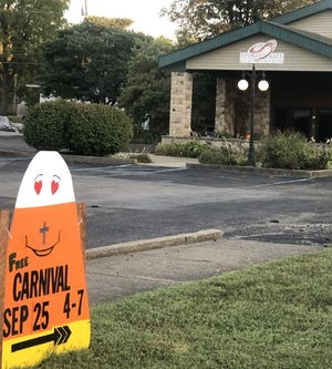The Spirit of Life church, with a candy corn sign advertising the carnival.